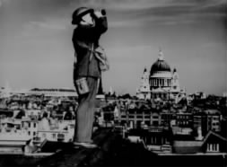 Aircraft spotter on the roof of a building in London. St. Paul's Cathedral