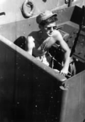 A photo of John F. Kennedy aboard PT-109 during World War II.  He joined the navy and was eventually made commander of the patrol torpedo (PT) boat pictured here.