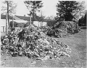 clothes stacked at Dachau.gif