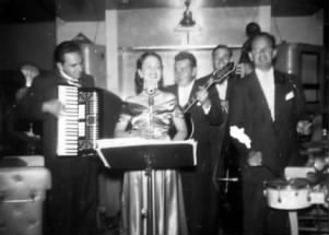 Here is Lola singing with her brother Frank Sugia, Gene Sargent, Hayden Shaner and Mori Simon. Among the many talented musicians Lola performed with are Kenneth Johnson, David Tuttle, Gordy Challstedt, Rollie Morehouse, Dave Stetler, Al Turay, and Marv Thomas (father of Seattle trumpet player, Jay Thomas).