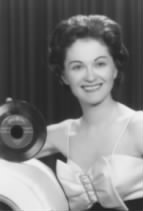 """Lola Sugia, married to song writer Johnny Forrest, posing with hit record, """"Blue Tears"""", in 1960.  Blue Tears is scheduled for re-release in 2010 on """"The Best of Golden Crest""""."""