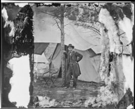 B-36 Lieutenant General Ulysses S. Grant Standing by a Tree in Front of a Tent, Cold Harbor, Virginia.