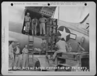 Loading patients onto an airplane in China