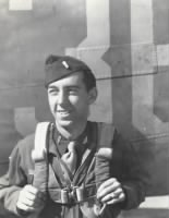 With parachute, volunteered to be gunnery officer on bombing raids  .jpg