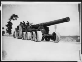 British gun going to its position, Ypres, Belgium. This shows a heavy artillery gun being transported along a road towards the Front