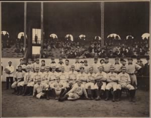 (The Pirates: Claude Ritchey, Harry Smith, Eddie Phelps, Ginger Beaumont, Deacon Phillippe, Sam Leever, Bucky Veil, Gus Thompson, Tommy Leach, Jimmy Sebring, Brickyard Kennedy, Fred Carisch and Honus Wagner. Middle: Fred Clarke. Boston players: J Collins, C Stahl, B Dineen, B Freeman, C LaChance, Dougherty, Winter, D Farrell, J O'Brien, T Hughes.)