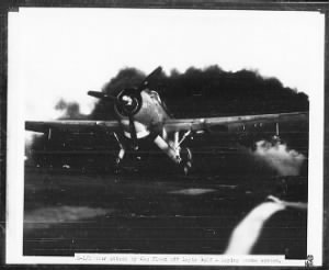 Fold3 Image - plane lays smoke screen during Battle of Leyte Gulf when Japanese central force attacks Taffy 3