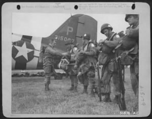 Fold3 Image - Paratrooper's equipment being inspected before leaving on invasion of Europe. Somewhere in England.